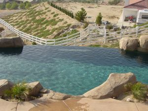 Vanishing Edge Pools #004 by Quality Custom Pools